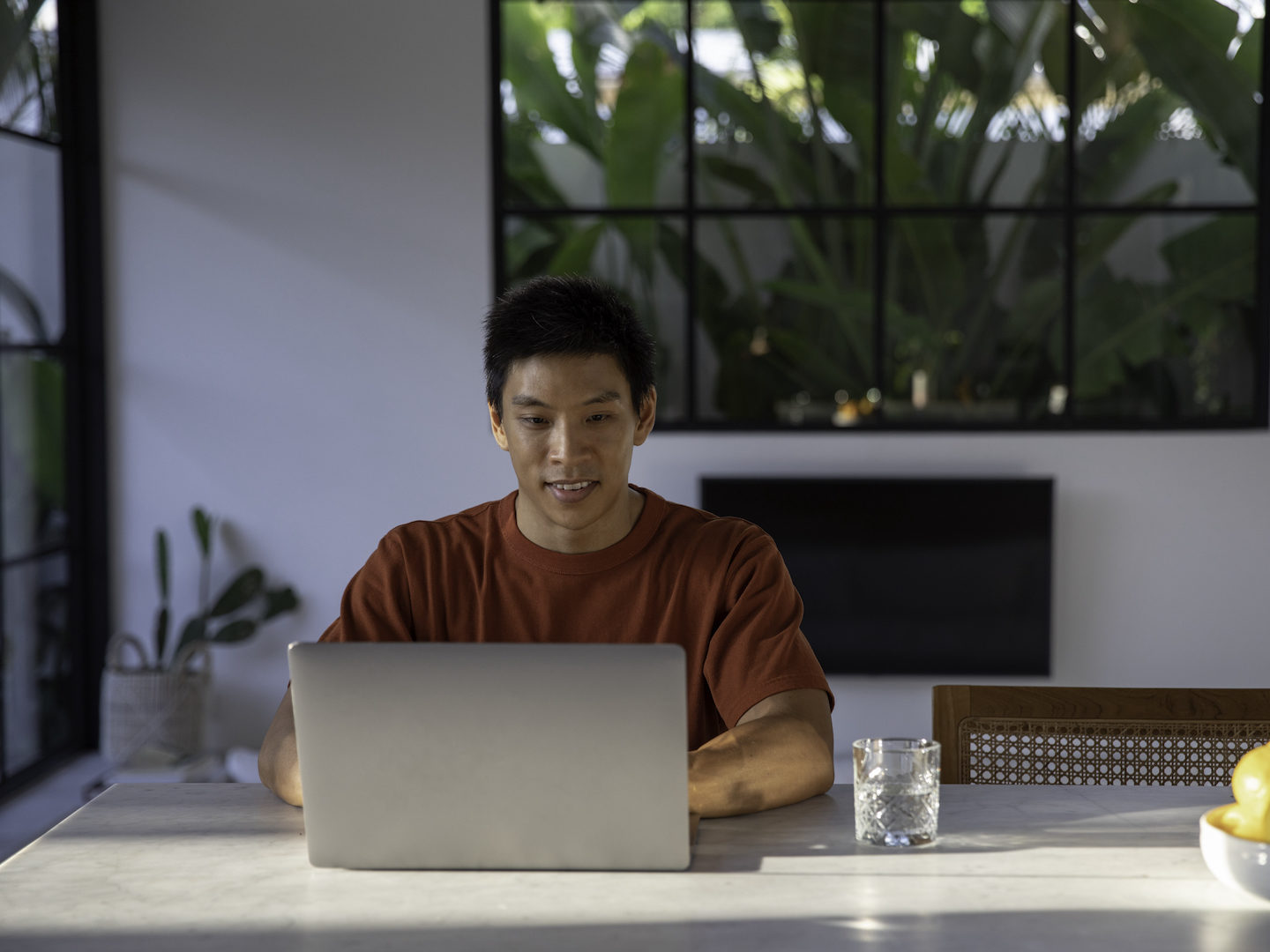 Asian man working from home lemons