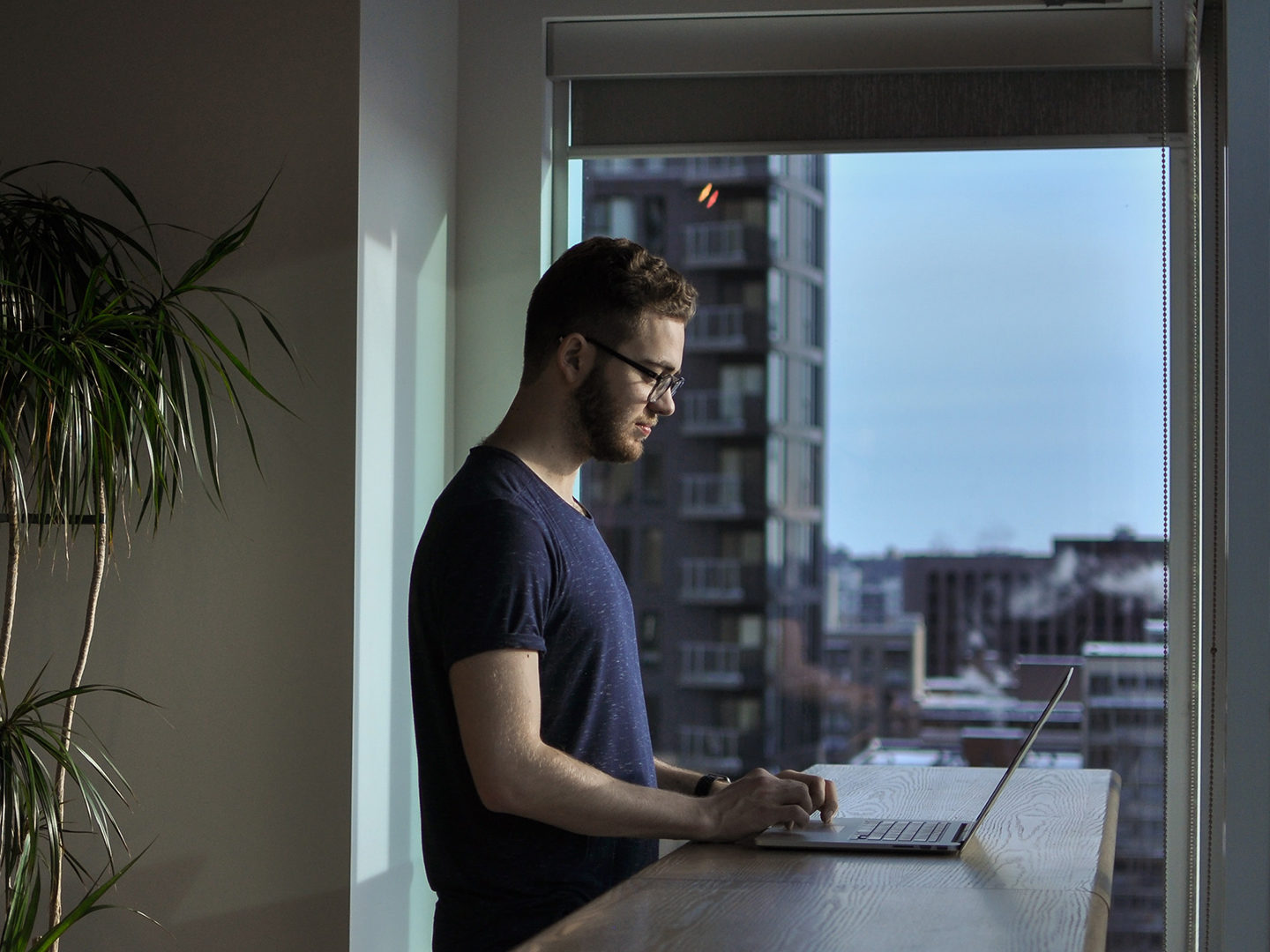 Man standing in city apartment
