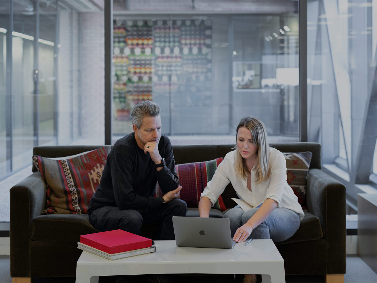 Man and woman reviewing work in office setting