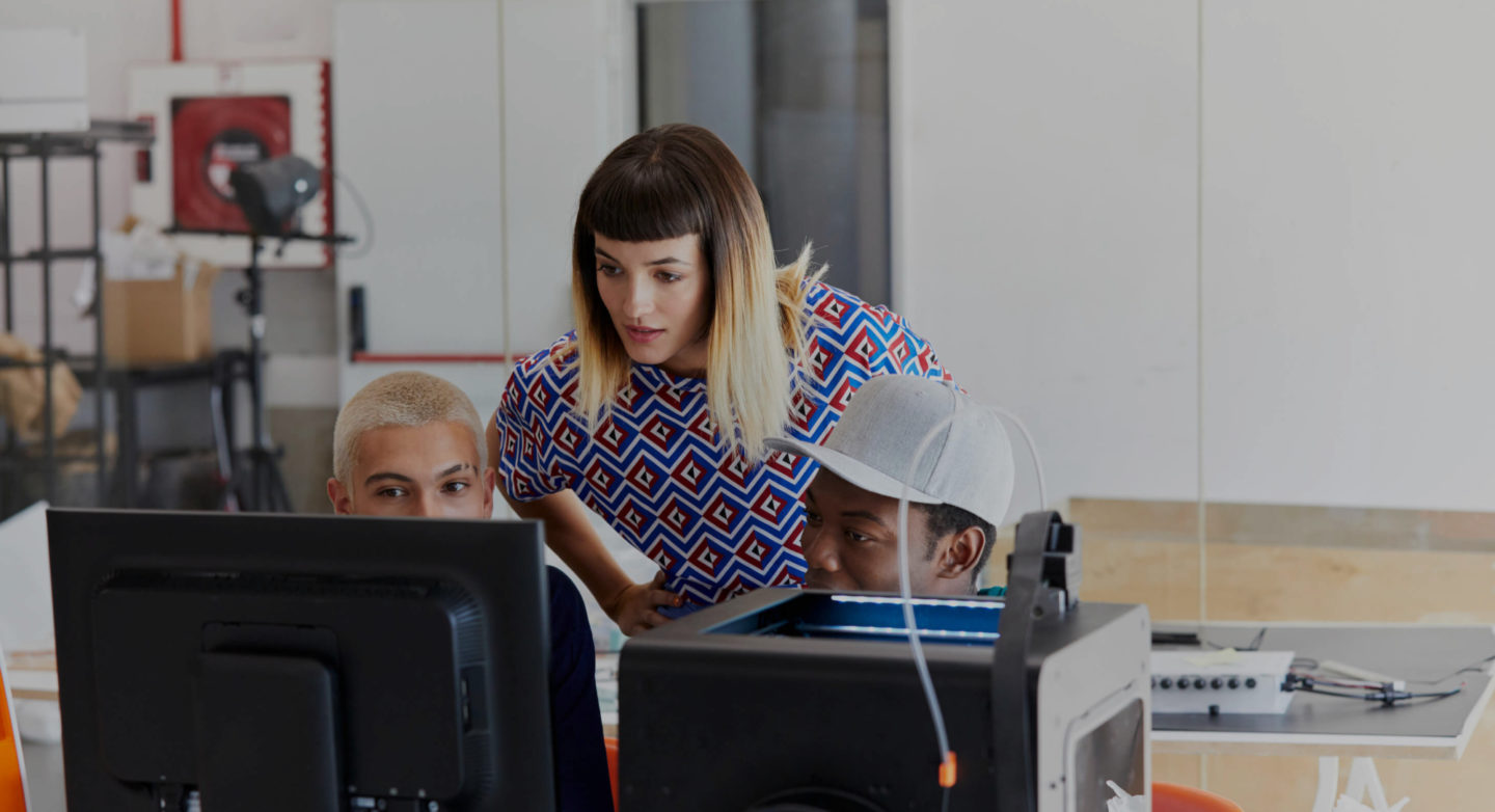Woman leaning in over monitor