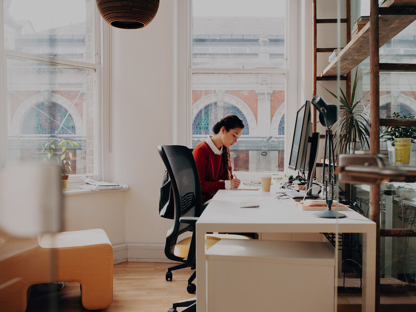 Woman working at long desk