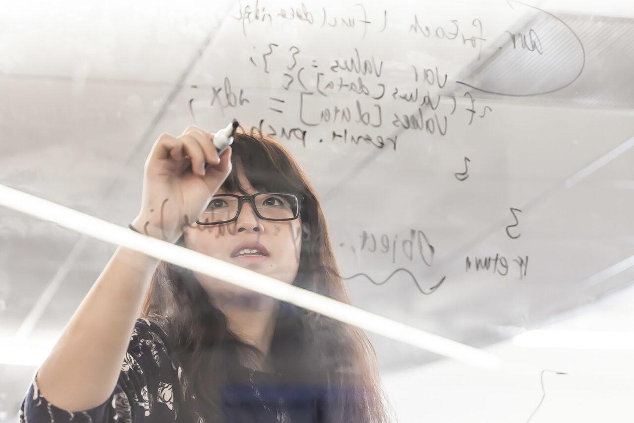 Girl solving coding problem