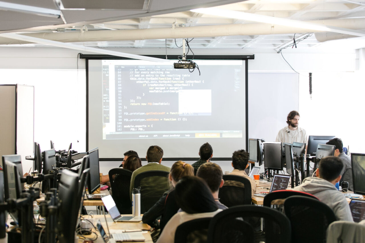 Students attending coding lecture
