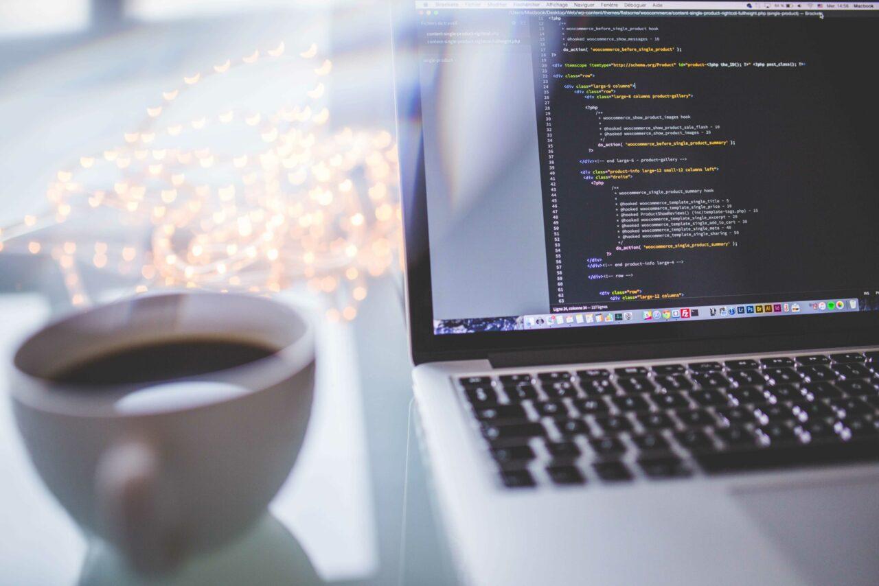 Code on screen coffee mug min