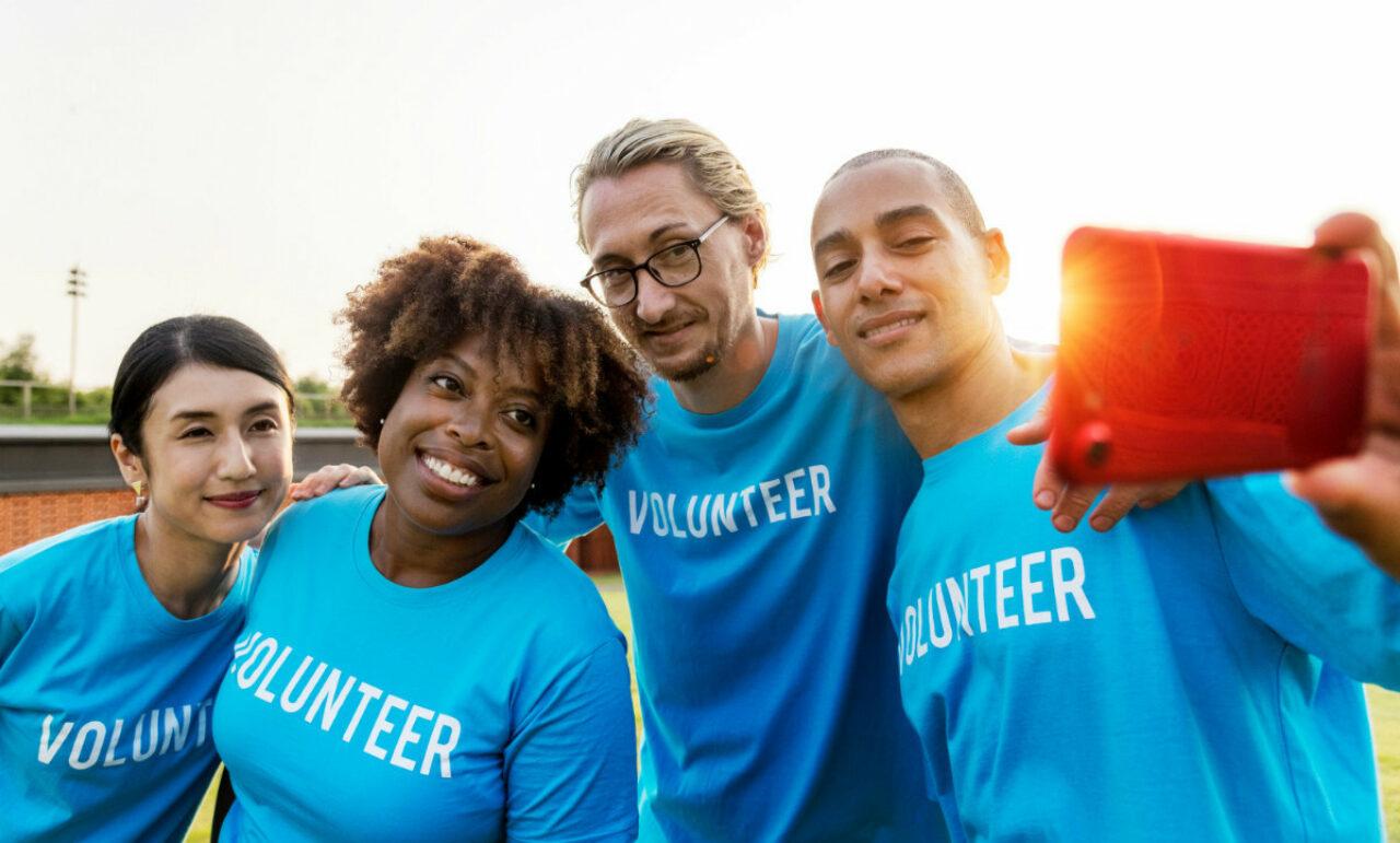 Team of nonprofit volunteers taking a selfie