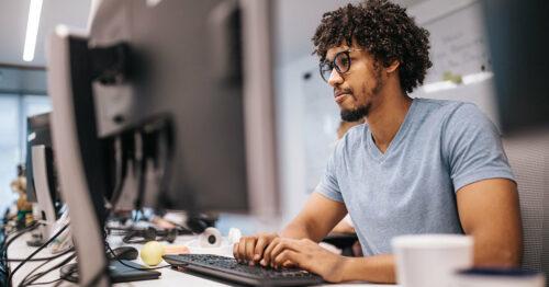 Man staring at computer wide