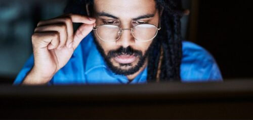 Man looking at screen with glasses