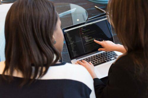 Women pointing at laptop