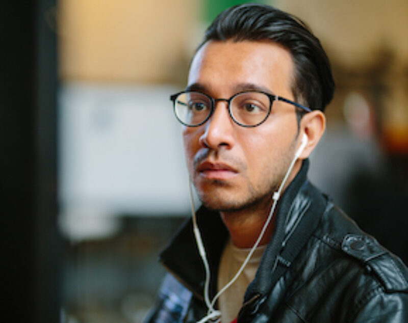 Man with glasses and headphones