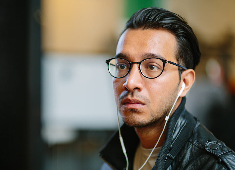 Man with glasses looking at screen small