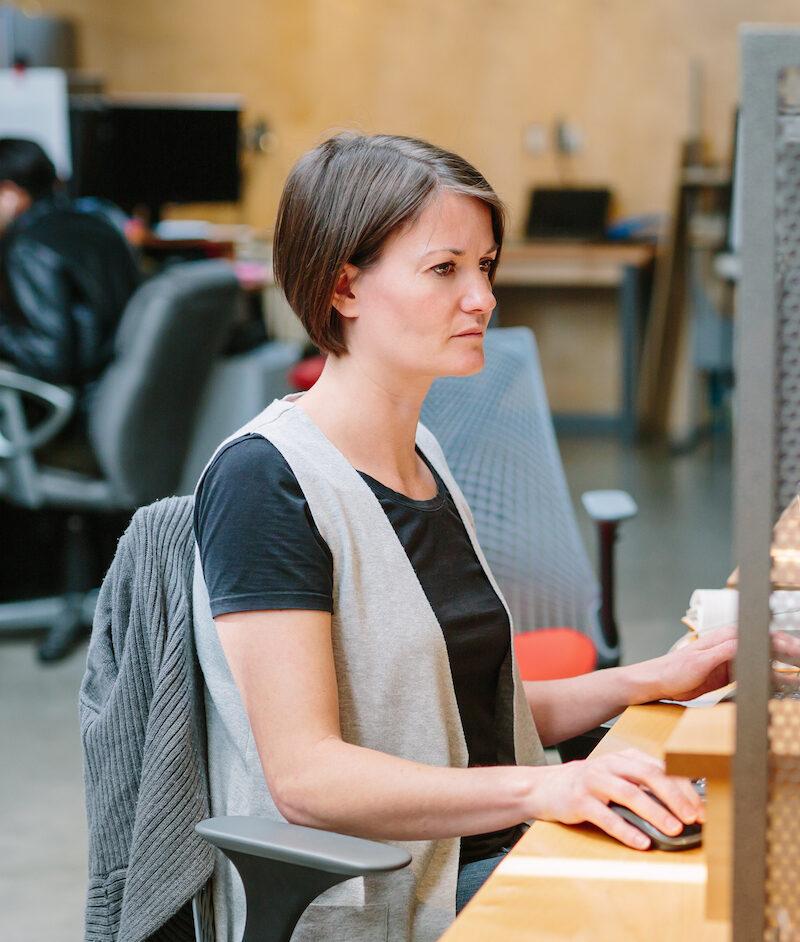 Focused woman in office working vertical