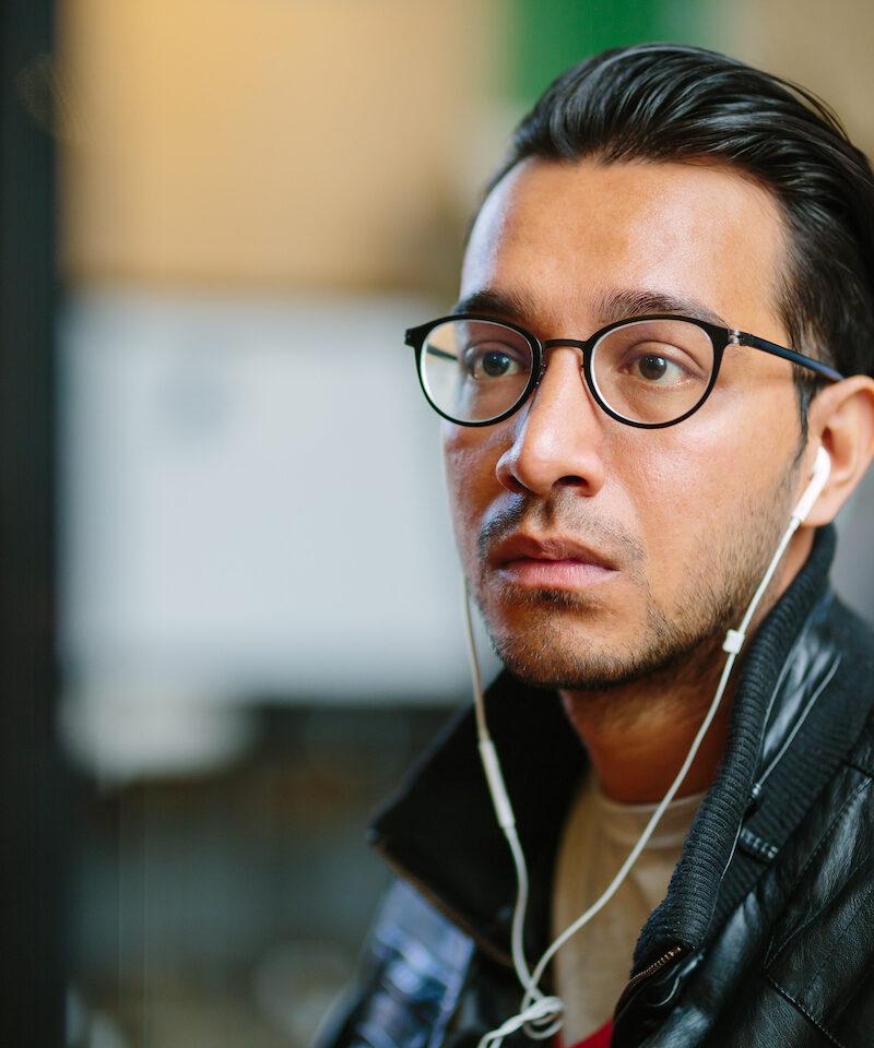 Man with glasses headphones