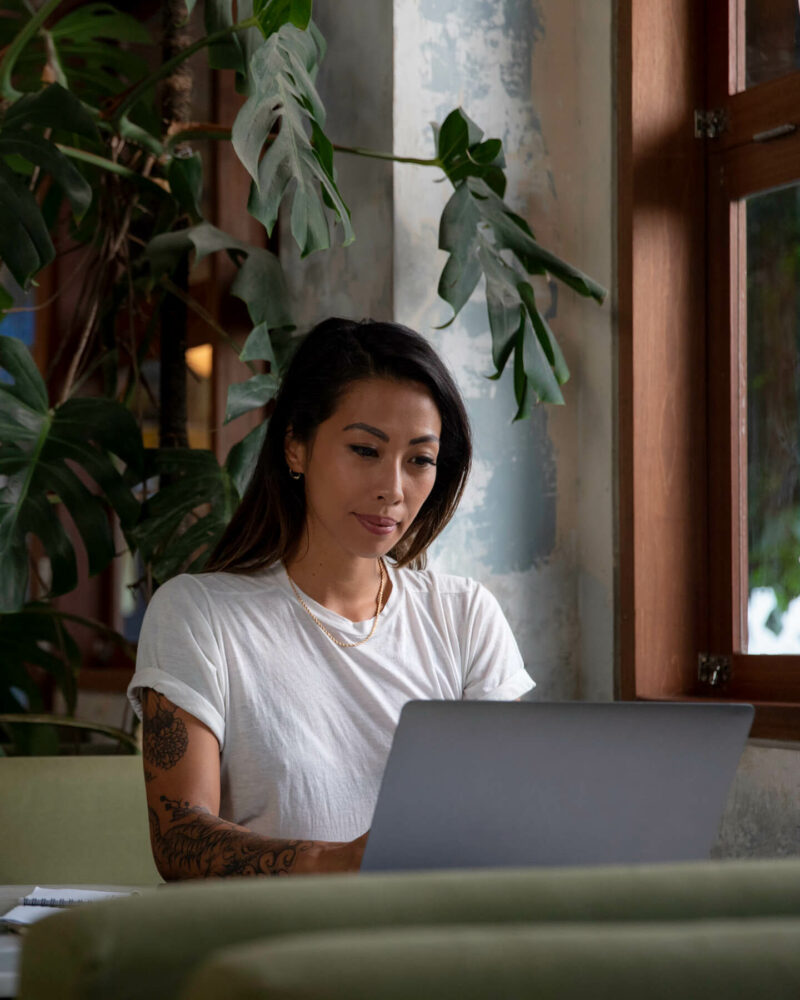 Woman in coffee shop typing